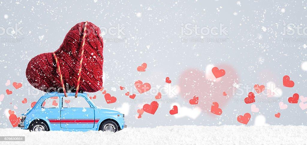 Retro toy car with Valentine heart stock photo