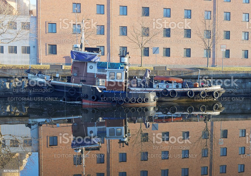 Retro tracker boats on the glassy canal in morning light stock photo