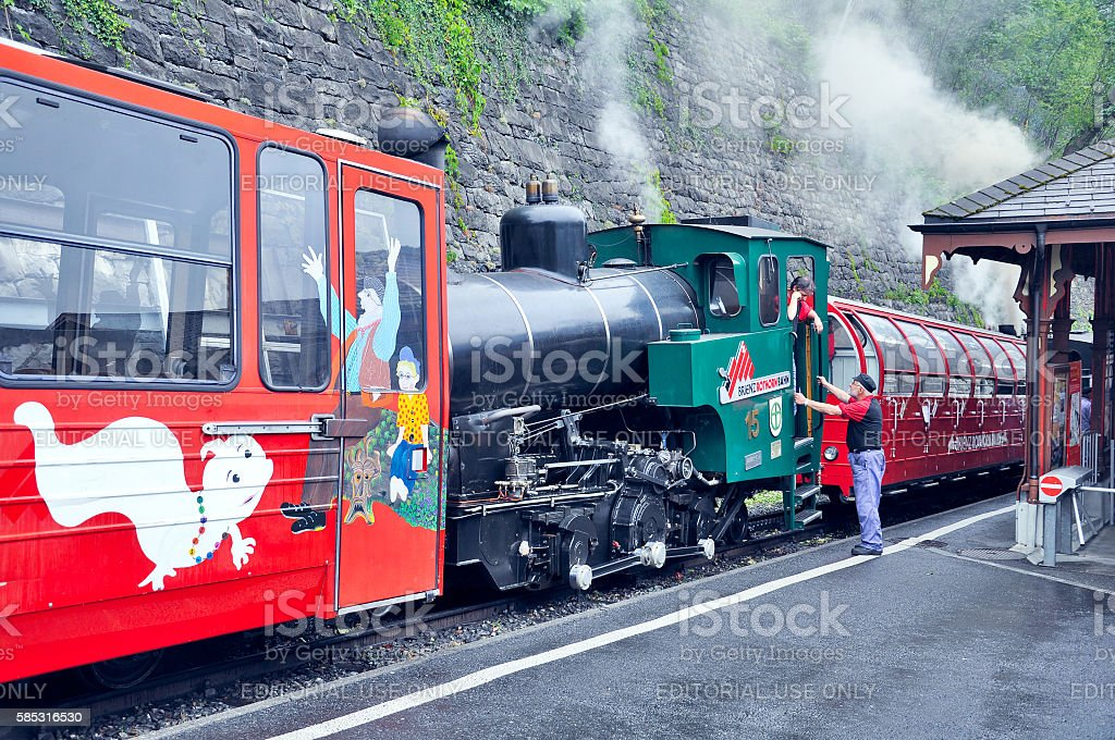 Retro train with locomotive crew before departure. stock photo