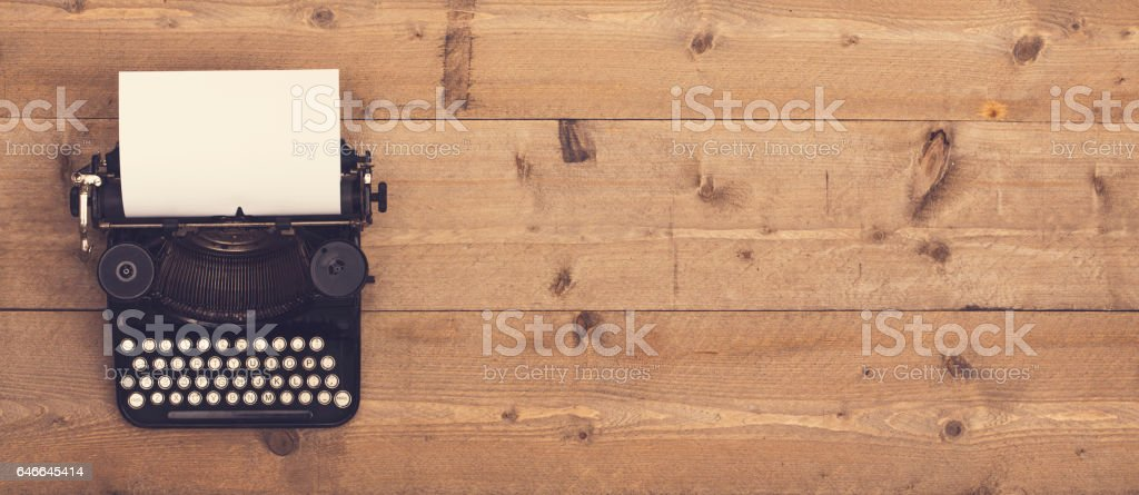 retro typewriter header stock photo