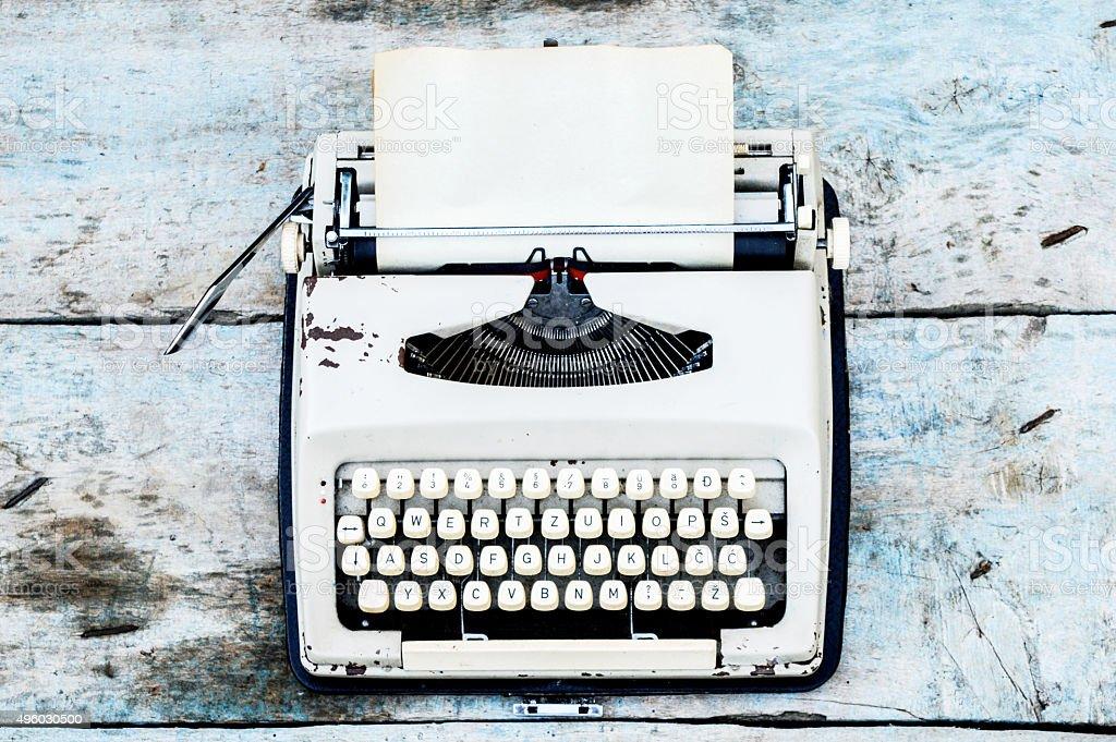 Retro typewriter on a wooden background stock photo