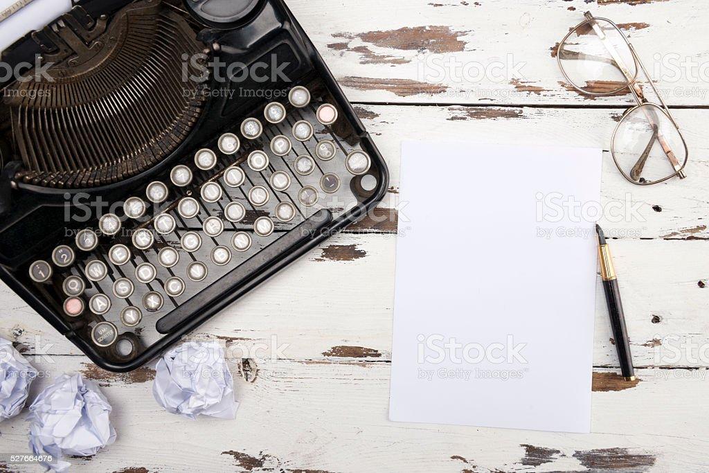 Retro typewriter on wooden board stock photo