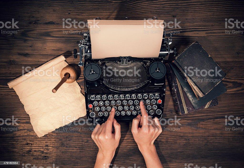 Retro typewriter on wooden planks stock photo