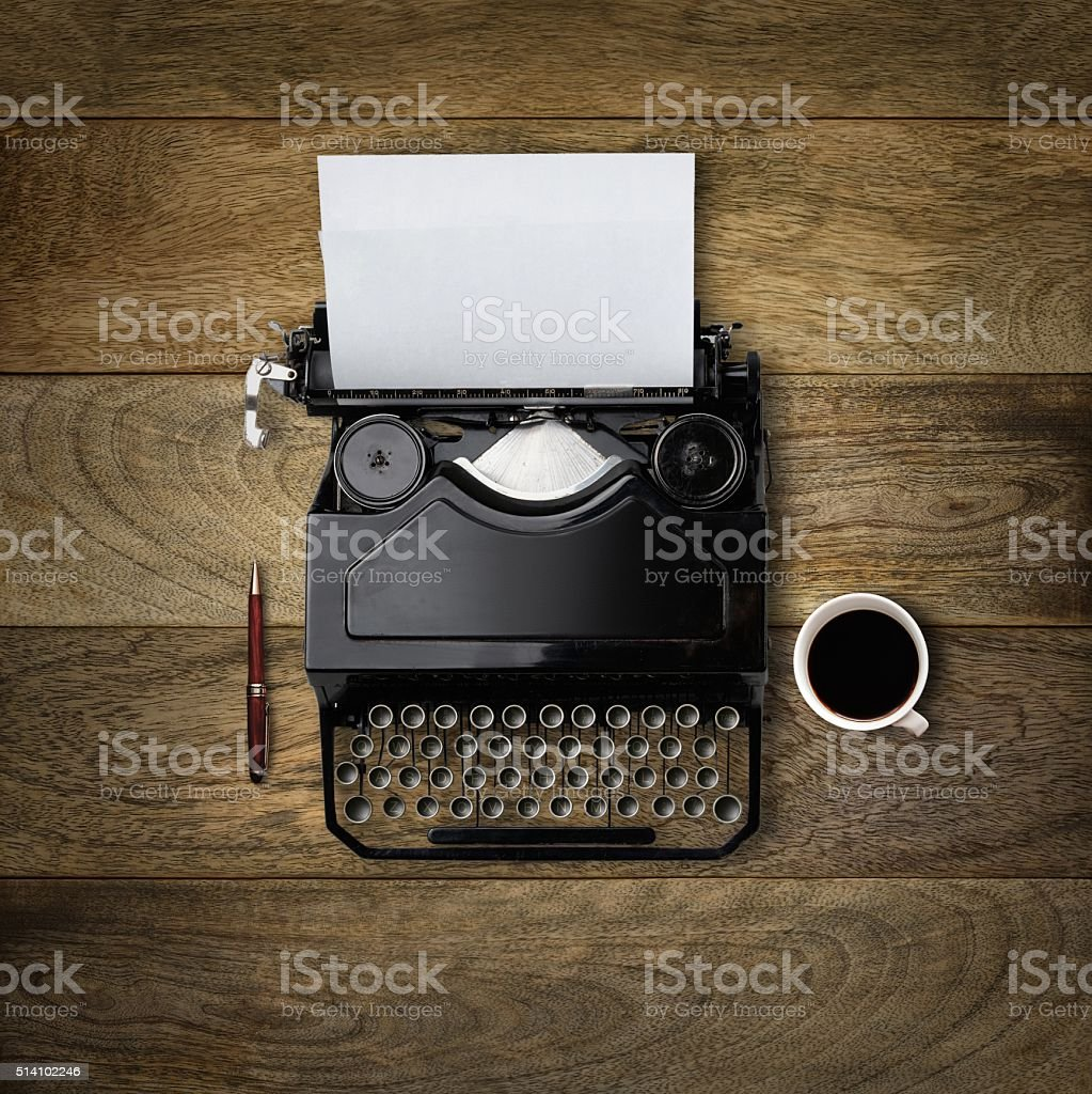 Retro typewriter on writers desk stock photo