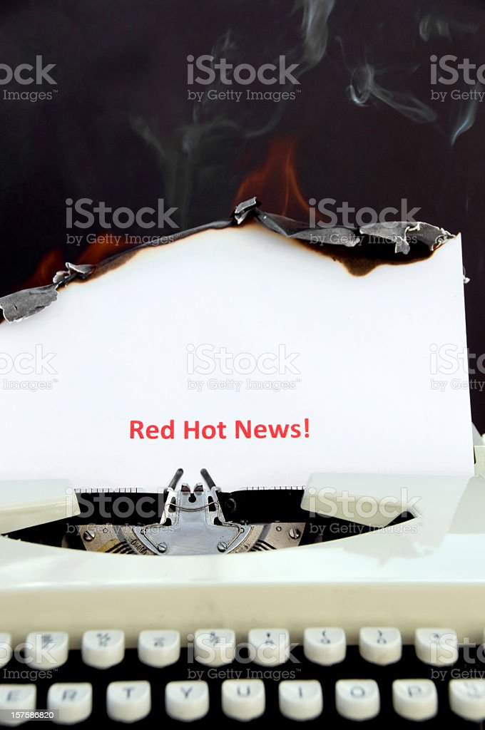 Retro Typewriter With Burning Paper ... Words Red Hot News! royalty-free stock photo