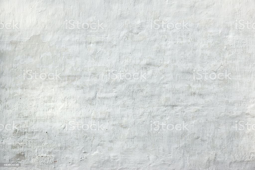 Retro Uneven Brick Wall With White Painted Plaster Background stock photo