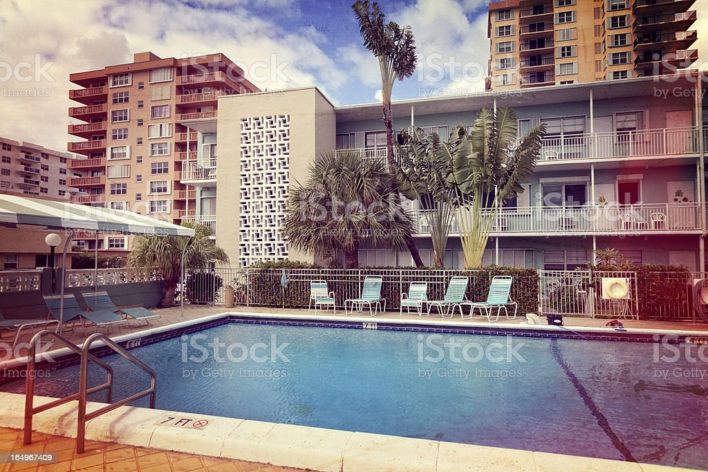 Retro vacation resort with swimming pool royalty-free stock photo