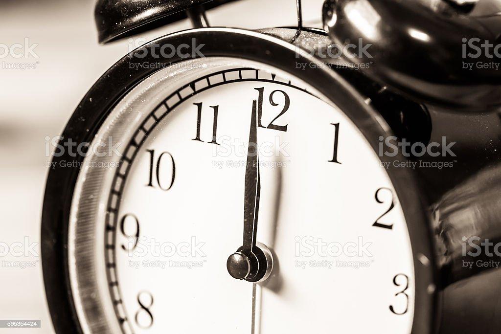 Retro vintage clock on sack closeup at 12 o'clock stock photo
