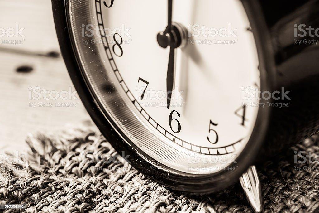 Retro vintage clock on sack closeup at 6 o'clock stock photo