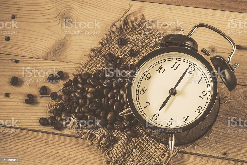 Retro vintage clock with coffee bean stock photo