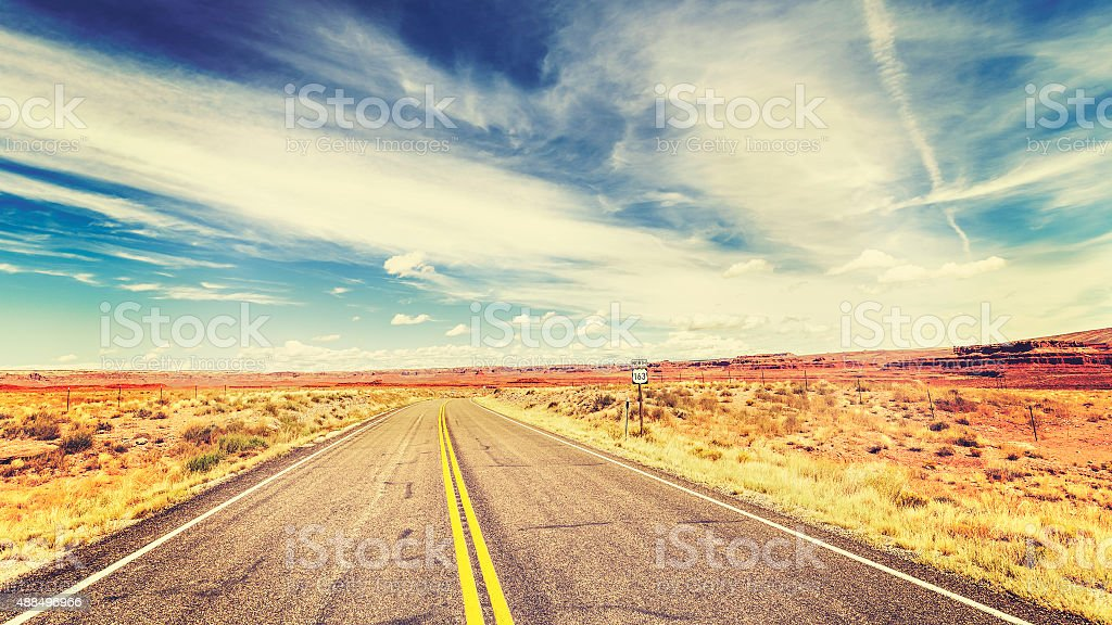 Retro vintage old film style endless country highway, USA. stock photo