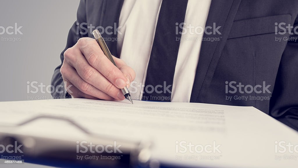 Retro vintage style image of a businessman signing a contract stock photo