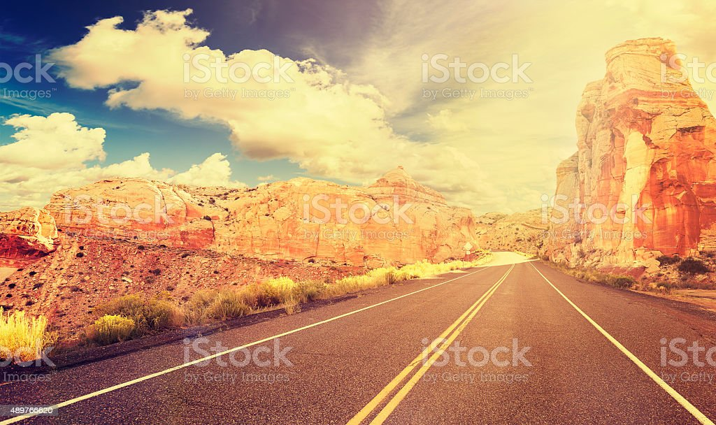 Retro vintage style mountain road at sunset, USA. stock photo