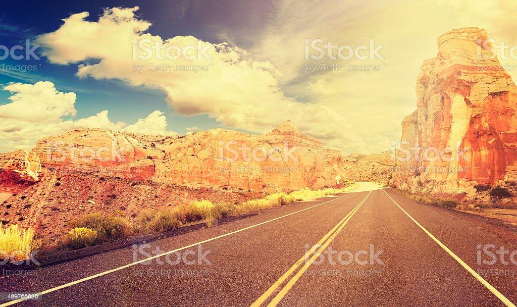 Retro vintage style mountain road at sunset, USA. stock photo