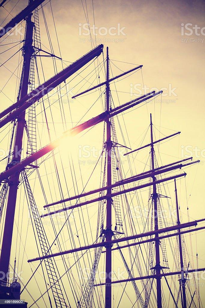 Retro vintage toned sailing masts at sunset. stock photo