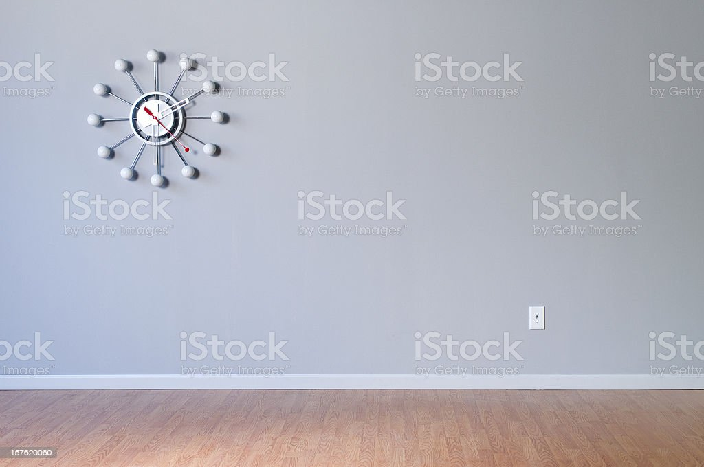 Retro Wall Clock In Empty Room royalty-free stock photo