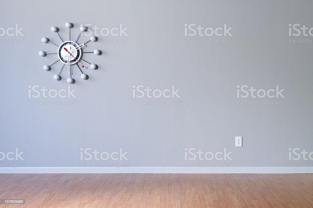 Retro Wall Clock In Empty Room stock photo