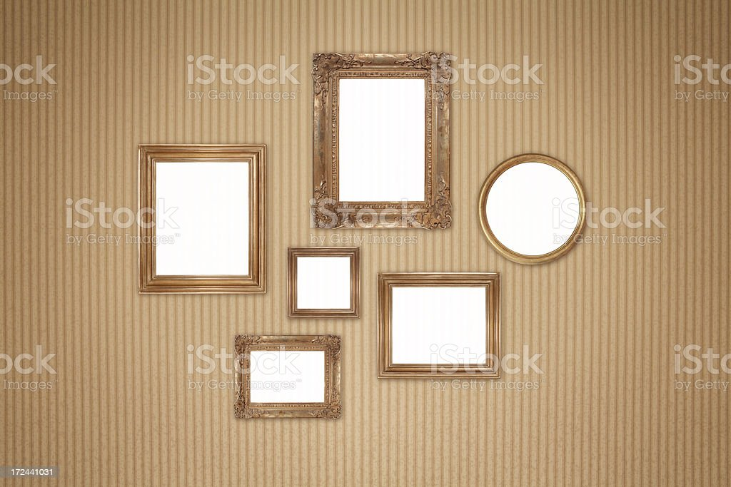 Retro wall with blank picture frames royalty-free stock photo