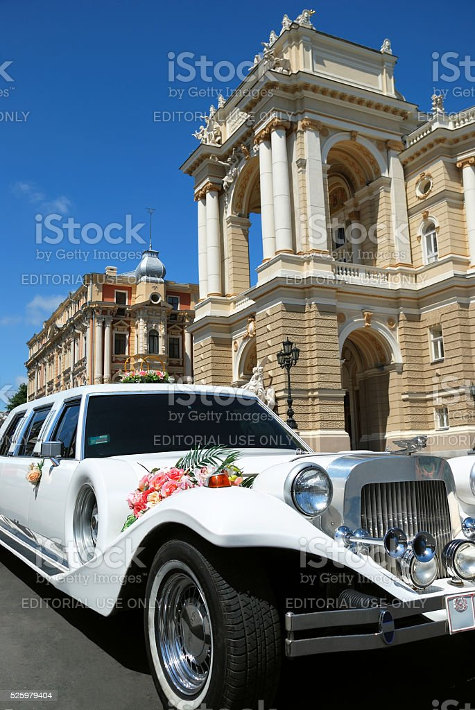 Retro white limousine decorated with flowers for wedding ceremony stock photo