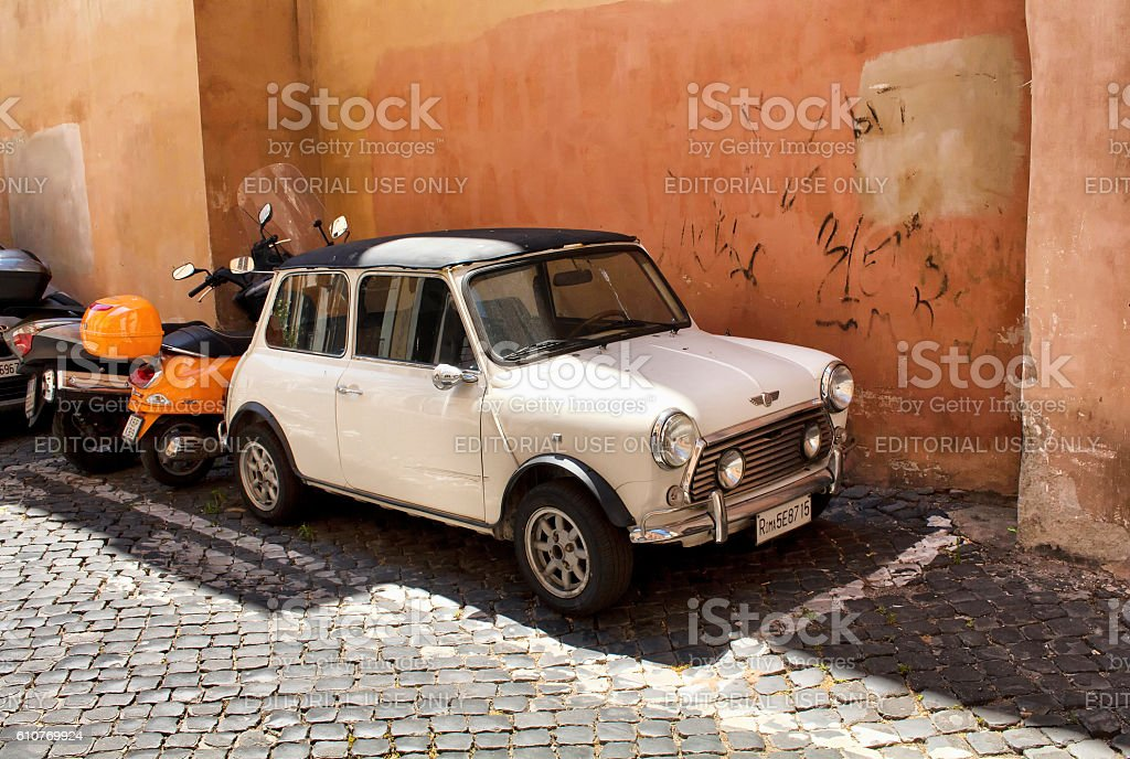 Retro, white, little, old car parked next to motorcycle stock photo