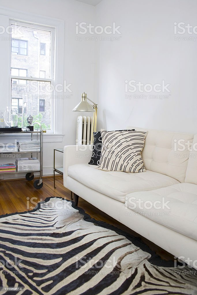 A retro white modern interior with a zebra rug royalty-free stock photo
