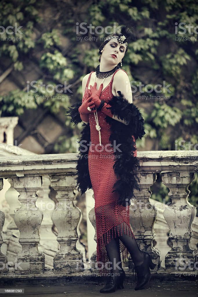 Retro Woman 1920s - 1930s in Red Dress stock photo