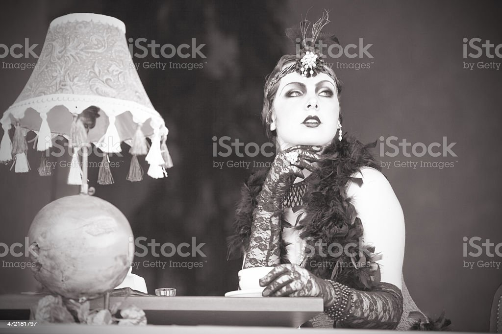 Retro Woman 1920s - 1930s Sitting with Cup of Tea stock photo
