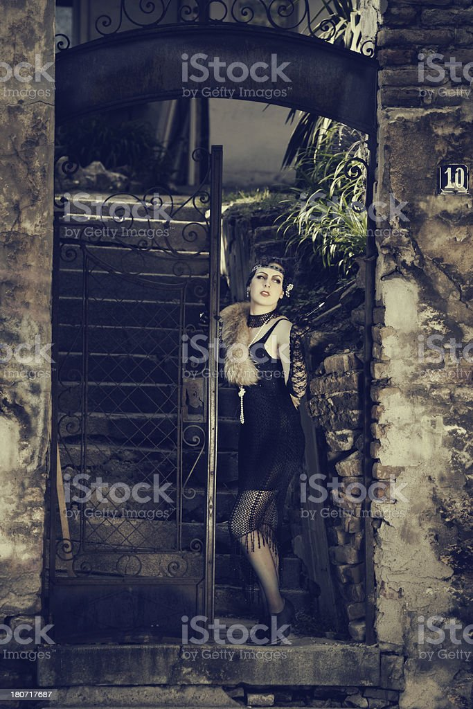 Retro Woman 1920s - 1930s Standing in the Gate royalty-free stock photo