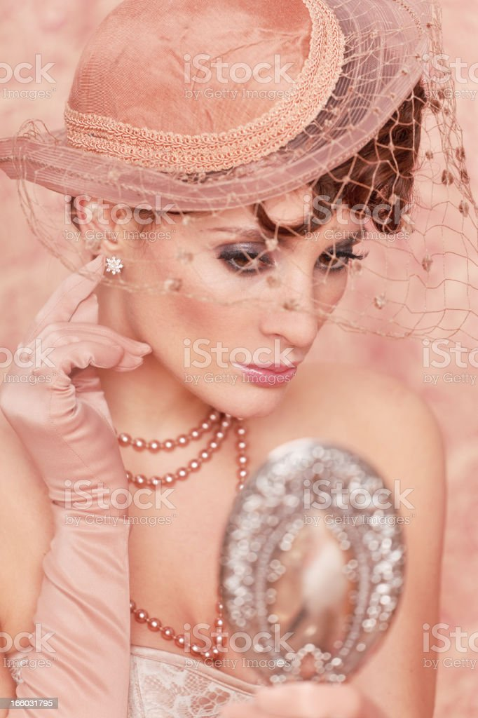 retro woman adjusting earring royalty-free stock photo