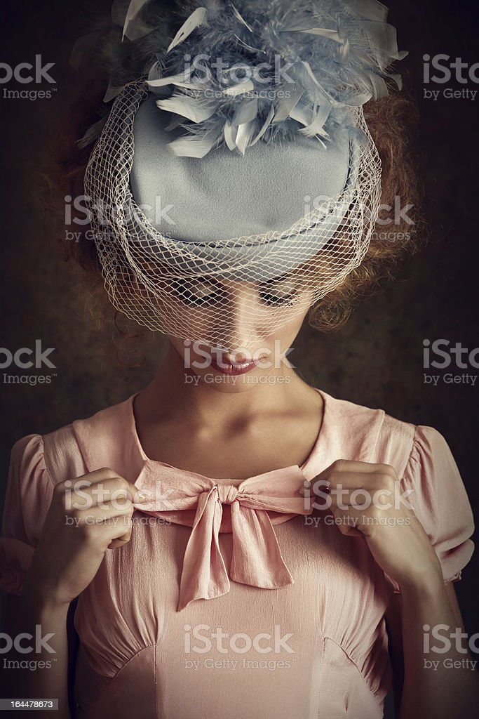 retro woman adjusting her clothes stock photo