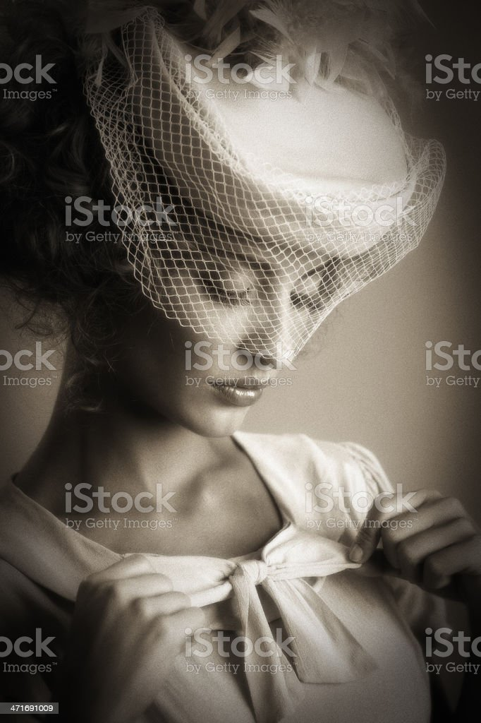 retro woman adjusting her clothes royalty-free stock photo
