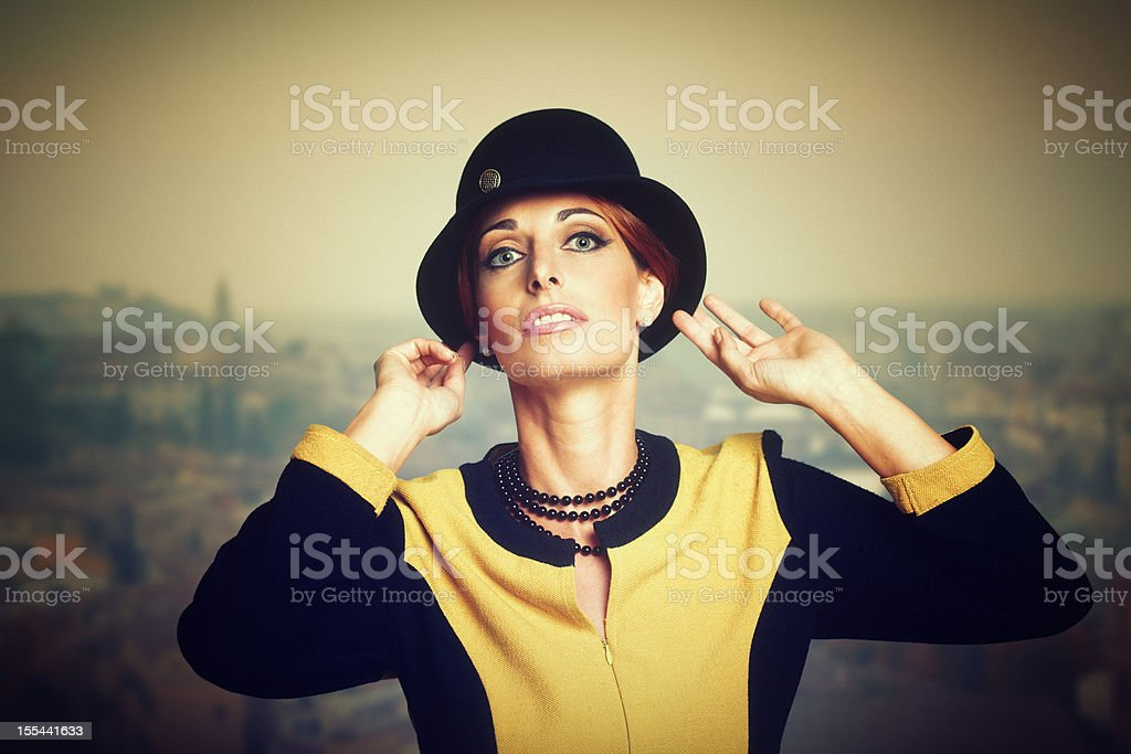 retro woman adjusting her hat royalty-free stock photo