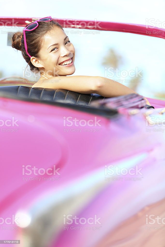 Retro woman happy in old vintage car royalty-free stock photo