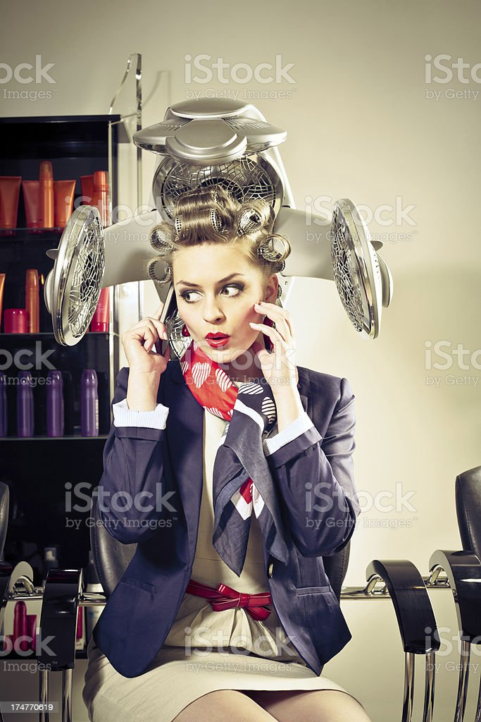 Retro woman in a hair salon royalty-free stock photo