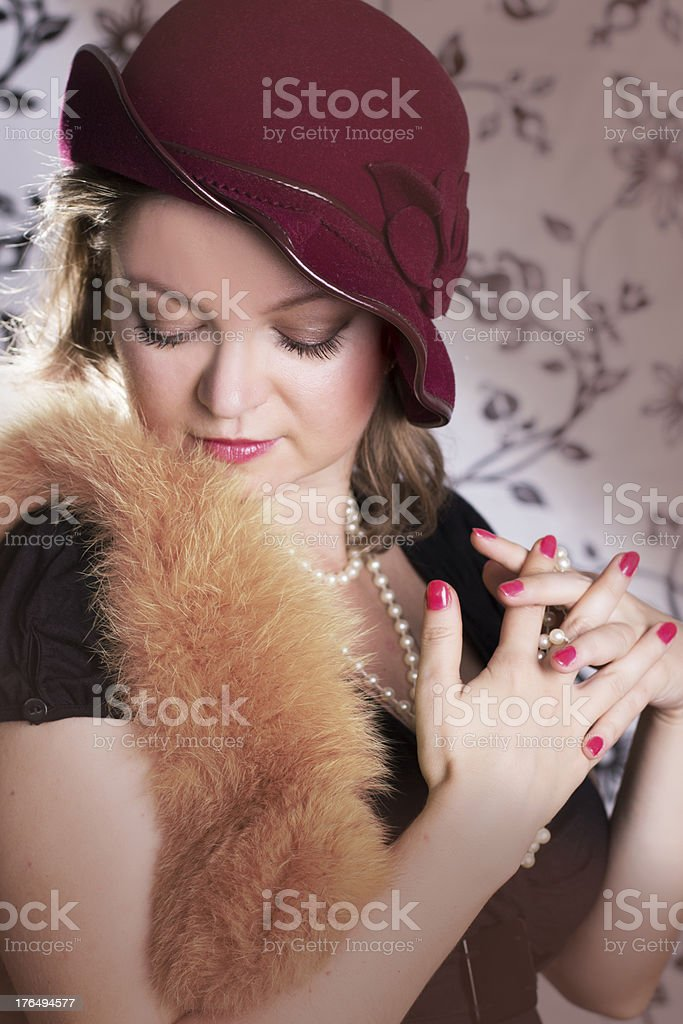 Retro woman in hat and boa with eyes closed royalty-free stock photo