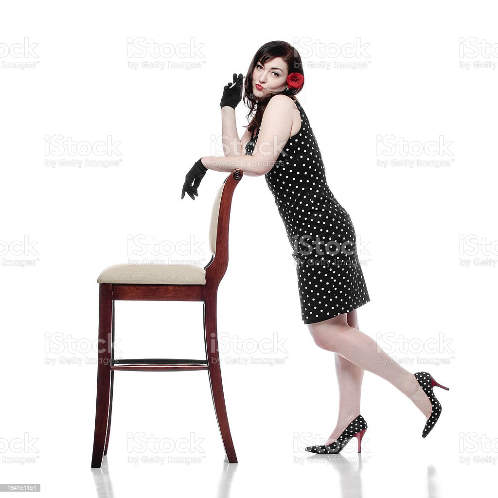 Retro Woman Leaning on Chair and Smoking royalty-free stock photo