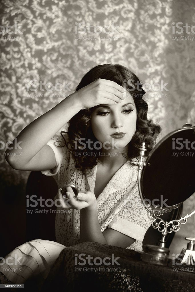 retro woman powdering face stock photo