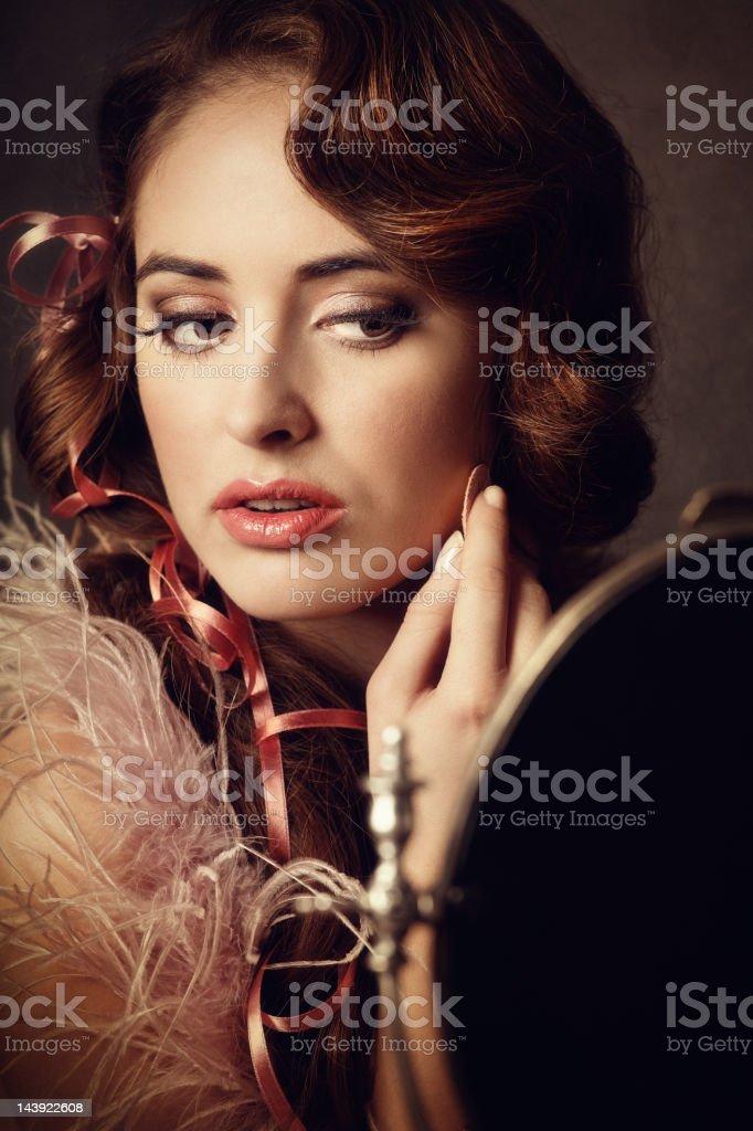 retro woman powdering face stock photo