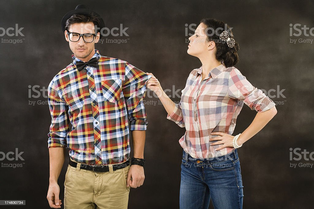 Retro woman pulling her boyfriends shirt stock photo