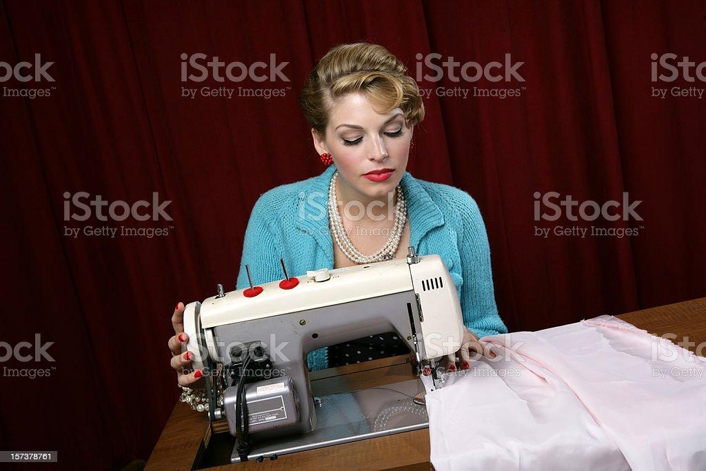 Retro Woman Sewing royalty-free stock photo