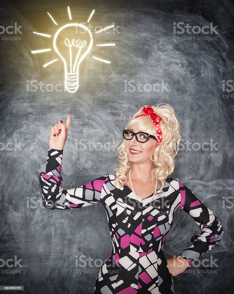 Retro woman showing on drawing lamp by finger stock photo