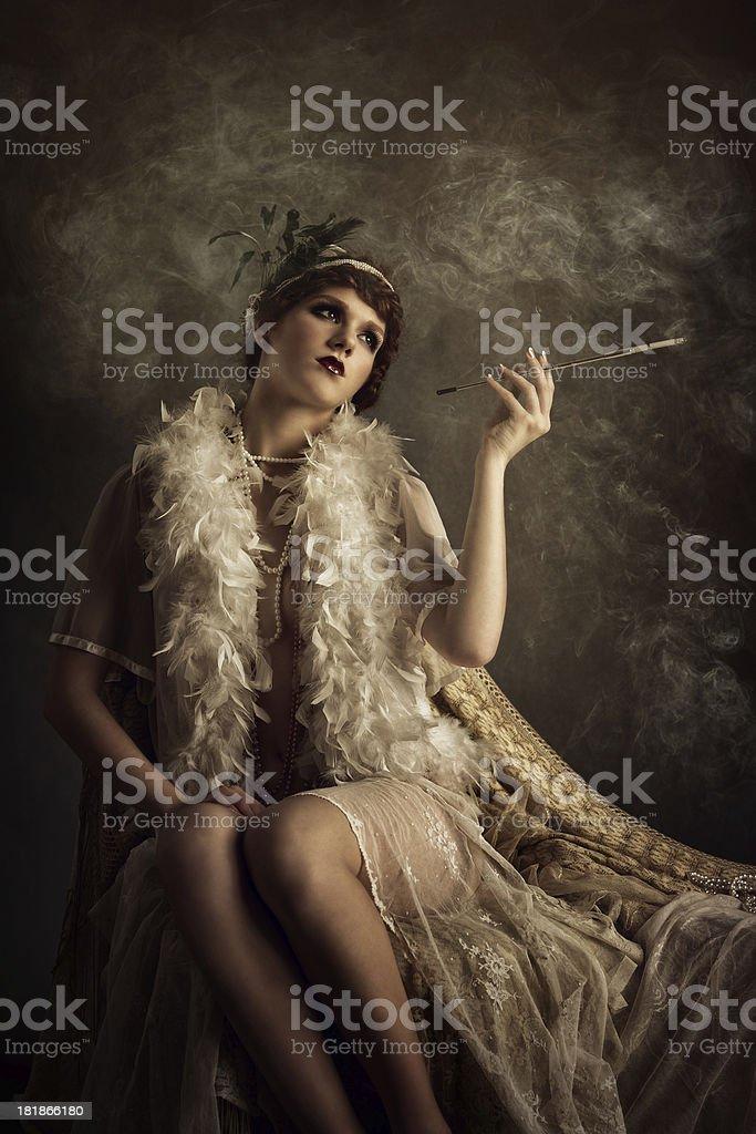 retro woman smoking cigarette stock photo