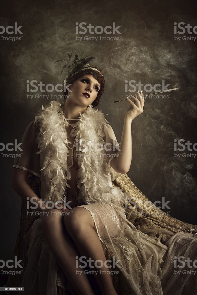 retro woman smoking cigarette stock photo