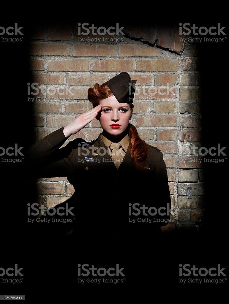 Retro Woman Soldier Saluting stock photo