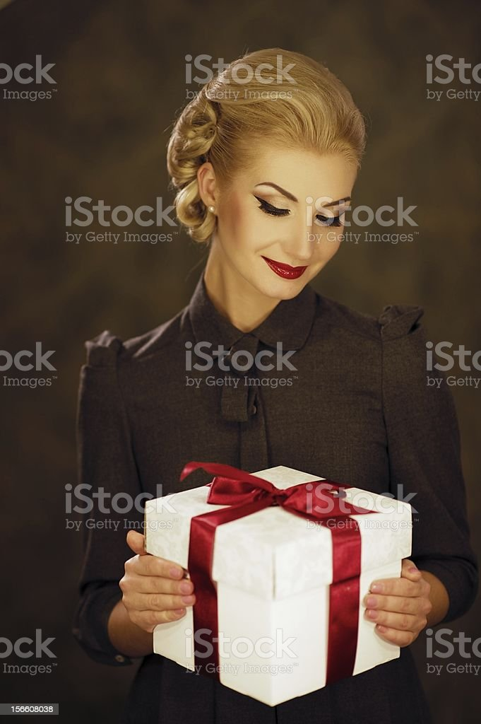 Retro woman with a gift box royalty-free stock photo