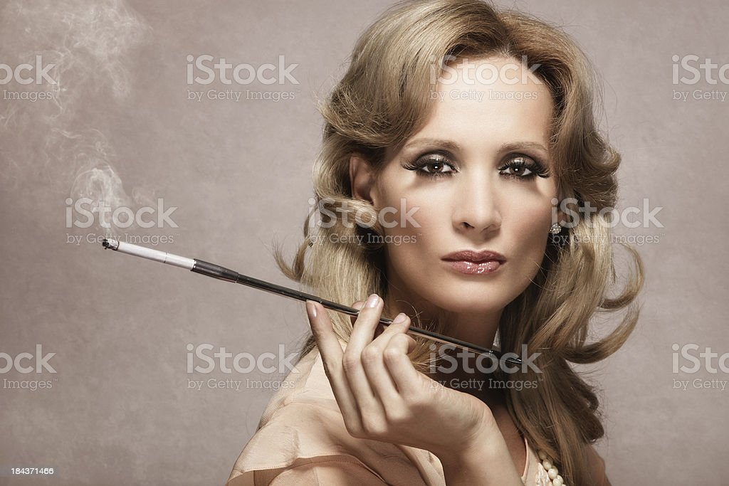 Retro woman with cigarette holder royalty-free stock photo