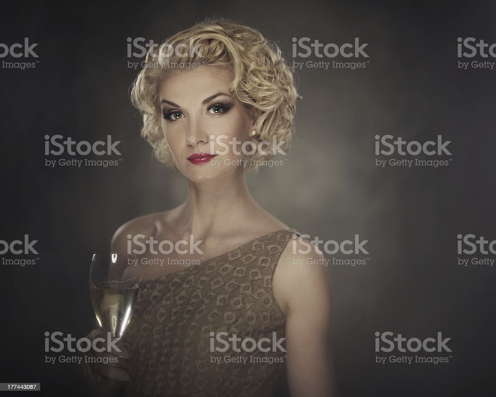 Retro woman with glass of champagne royalty-free stock photo