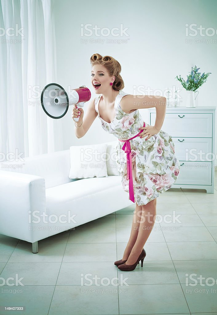 Retro woman with megaphone royalty-free stock photo