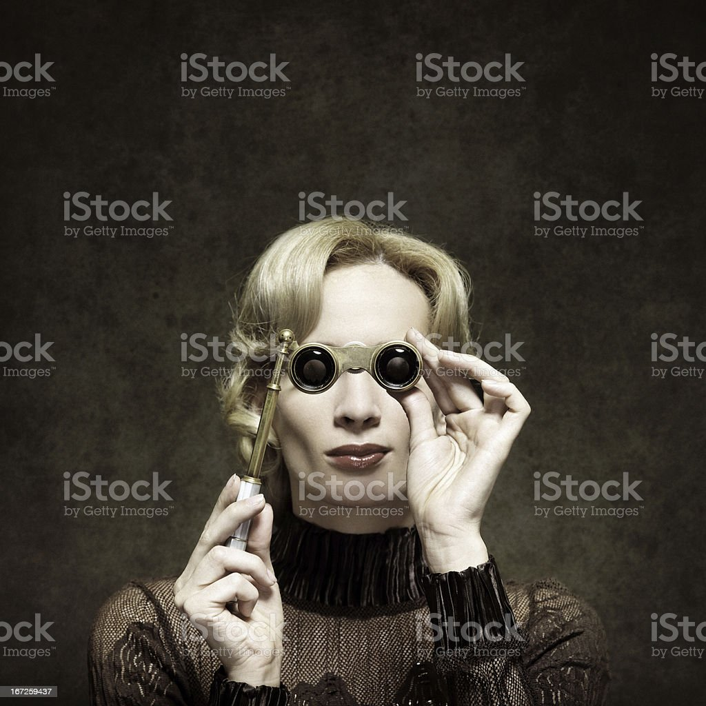 retro woman with opera glasses royalty-free stock photo