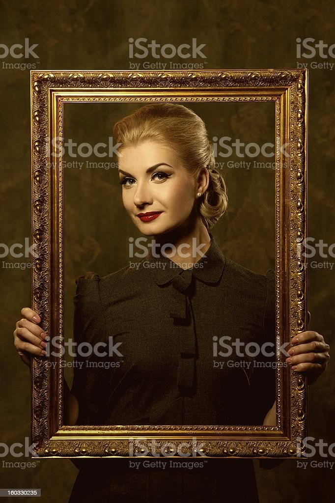 Retro woman with picture frame royalty-free stock photo